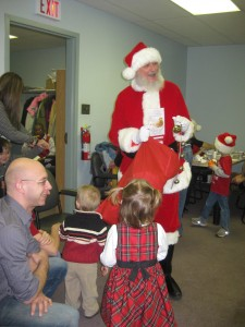 Photo of the end of winter term party 2012, with Santa and children.