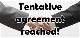 """Tentative agreement reached!"" over hands shaking."